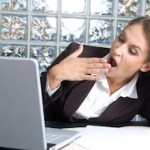 Woman_tired_yawning_laptop